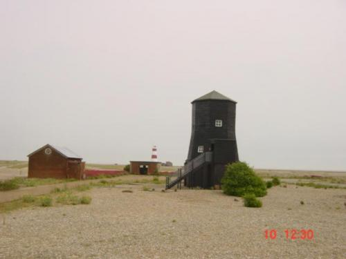 Orford Ness June 24th 2004-Bomb Ballistics building and lighthouse beyond jpg